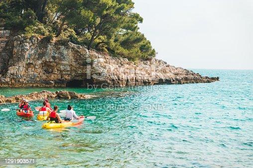 Pula, Croatia - June 5, 2019: people kayaking near blue bay of sea copy space
