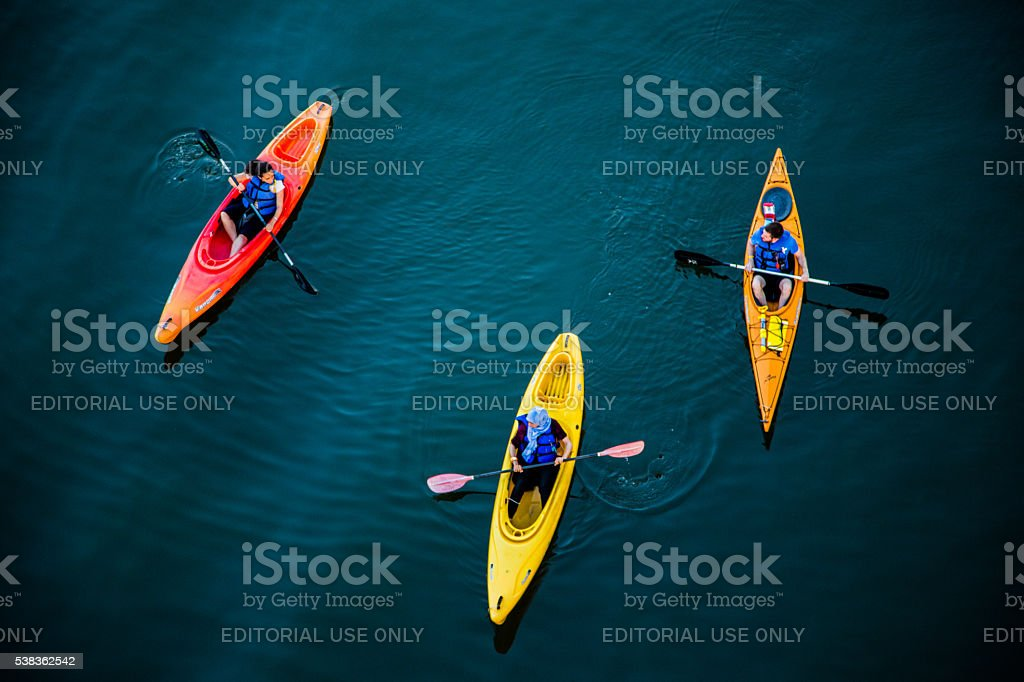 People Kayaking on the river stock photo