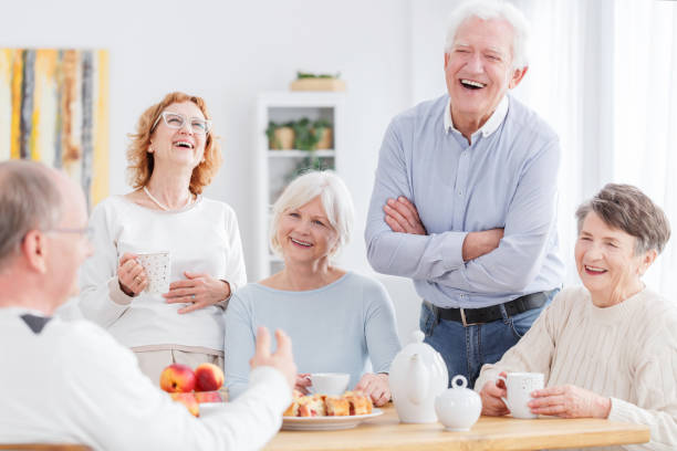 People laughing together Group of happy older people laughing together on a meeting retirement community stock pictures, royalty-free photos & images