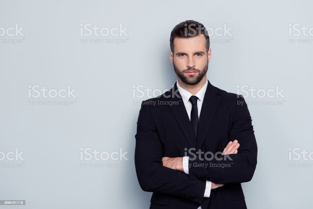 People leadership profession official concept. Portrait of serious concentrated focused confident severe handsome expert experienced qualified instructor with crossed arms isolated on gray background stock photo