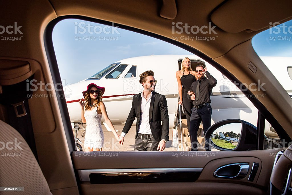 People leaving the airplane viewed from the car stock photo