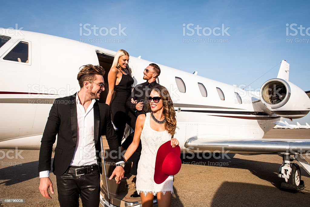 People leaving the jet airplane stock photo