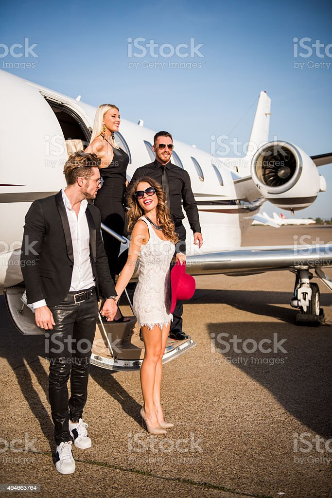 People leaving the private aeroplane stock photo