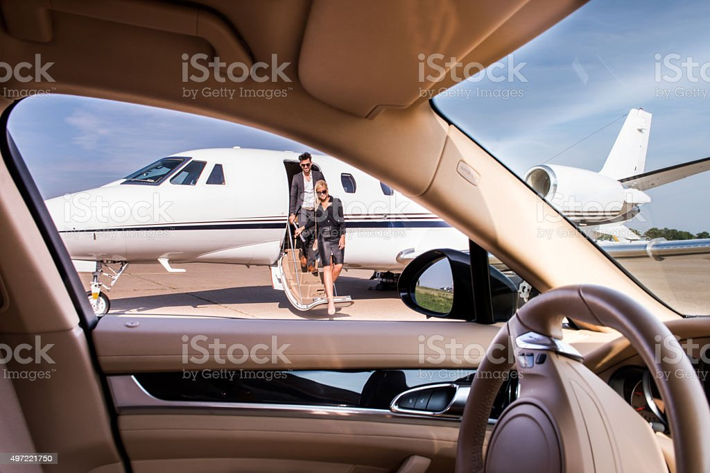 People leaving the private jet aeroplane stock photo