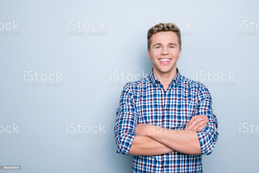 People lifestyle person marketer model employment concept. Portrait of friendly cheerful handsome confident clever smart rejoicing man standing with crossed arms isolated on gray background copy-space royalty-free stock photo