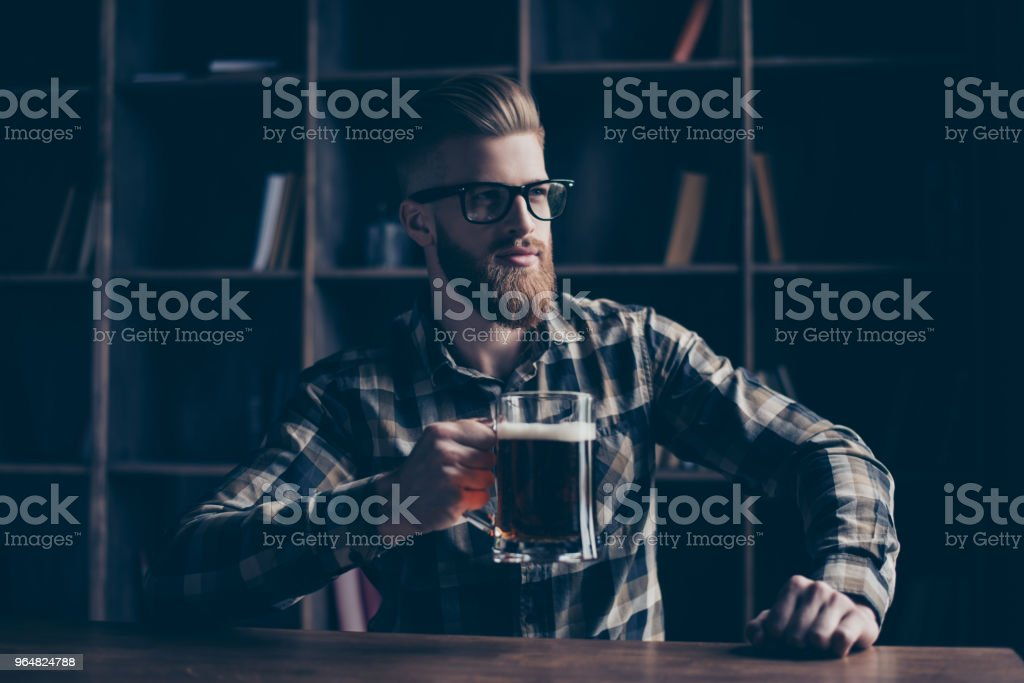 People lifestyle recreation pause break comfort coziness concept. Portrait of serious concentrated nervous dreamy handsome careless basketball fan watching tv in a cafe pub sitting at bar counter royalty-free stock photo