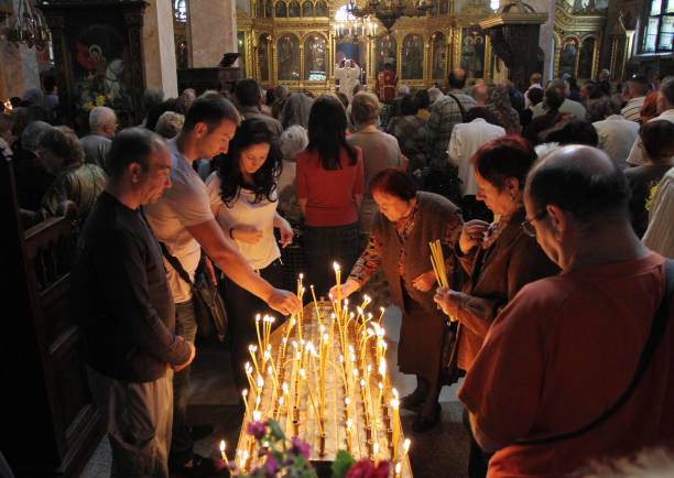 People light candles in Saint George church during a big holiday in Sofia, Bulgaria on may 6, 2012. stock photo
