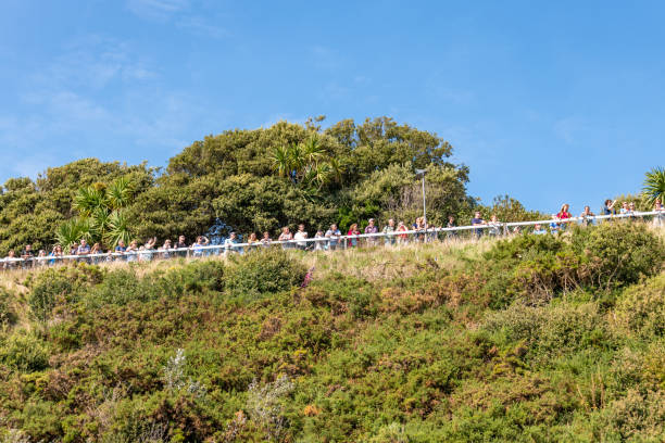 People line the cliffs watching the aerial displays at the Bournemouth Air Festival stock photo