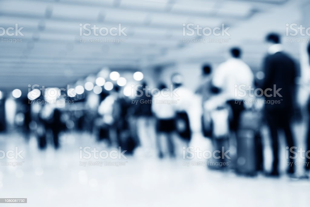 People lined up and waiting in airport stock photo