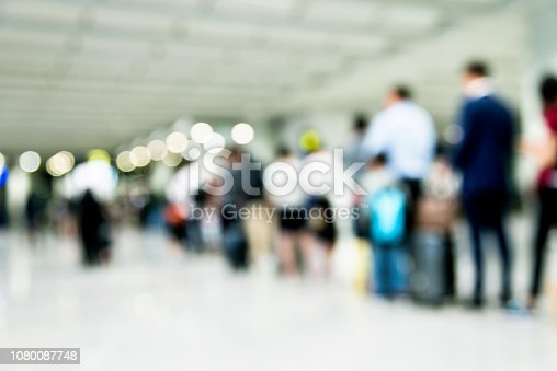 People lined up and waiting in airport.