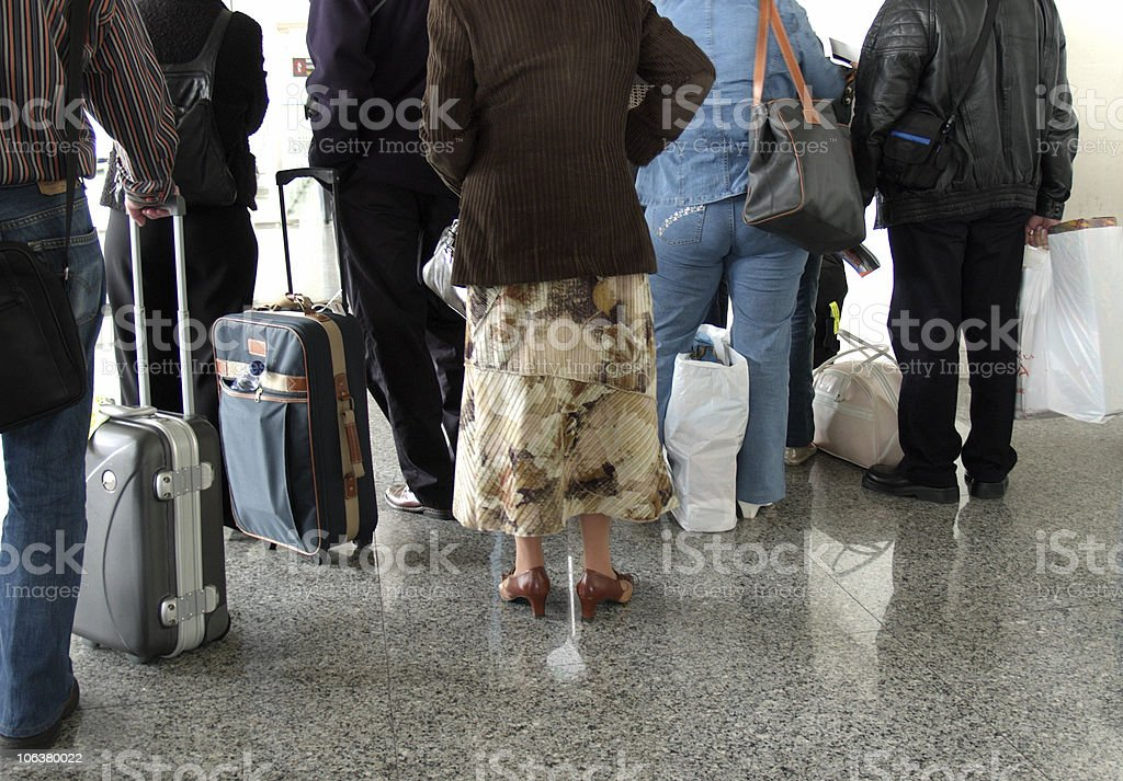 People lining up with their suitcases to board a plane royalty-free stock photo