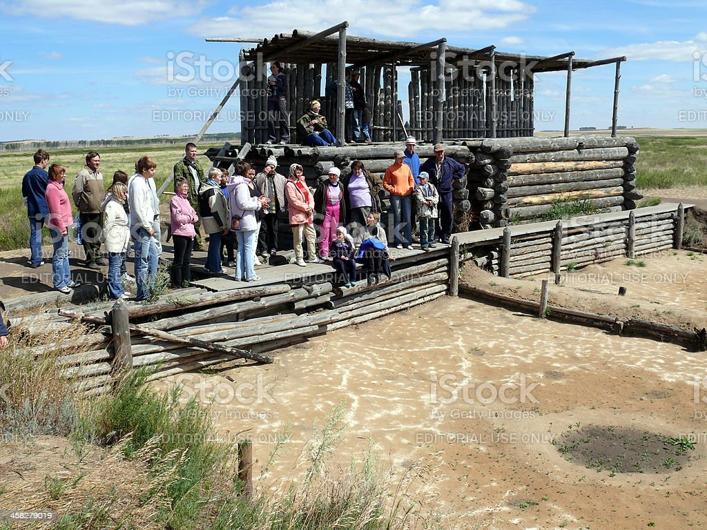 People listen guide in excavations place, Arkaim, Chelyabinsk area, Russia stock photo