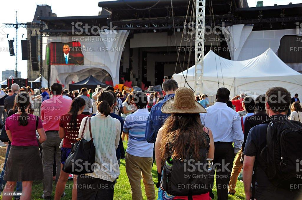People listen to Obama speech in Ottawa stock photo