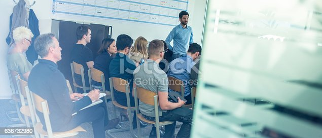 603992132 istock photo People listening to a seminar presenter 636732980
