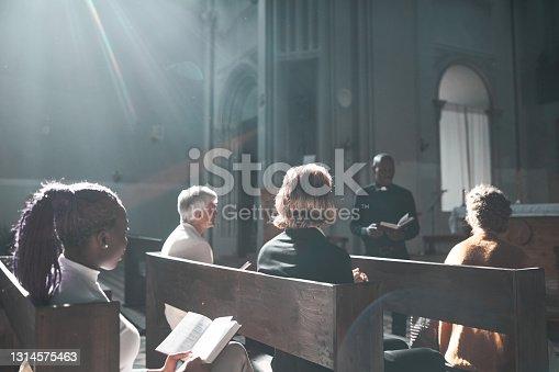 istock People listening to priest 1314575463