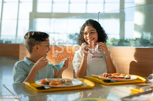 Siblings, Smiling, Removing, Protective mask, Lunch