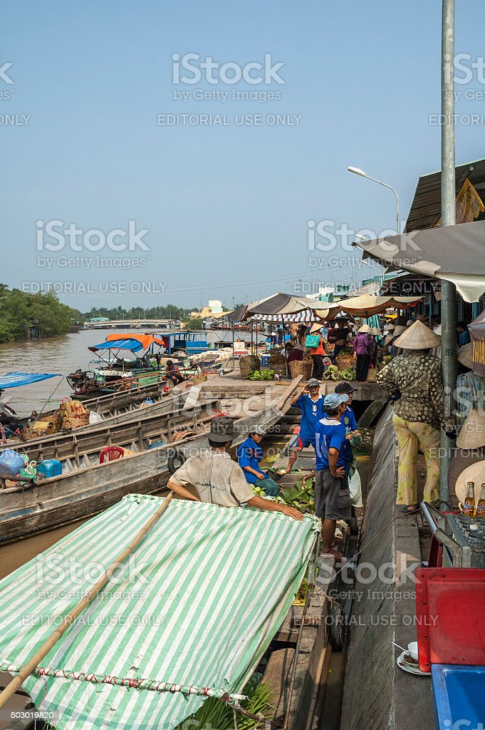 People Loading Boats Behind The Market In Vinh Long, Vietnam stock photo