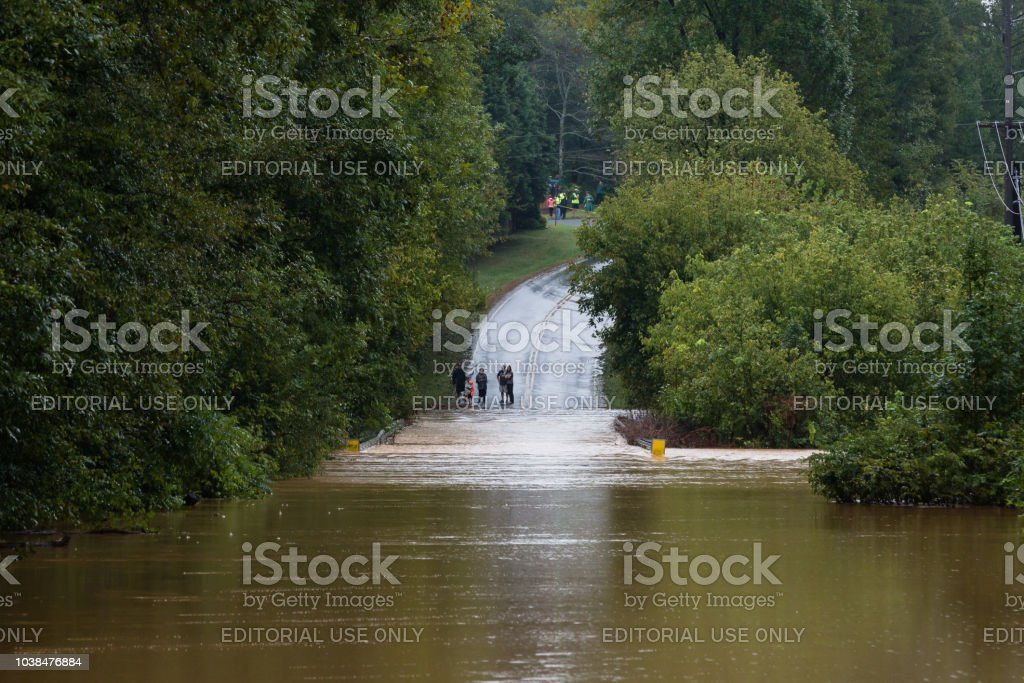 People look at a road in Union County, NC that is flooded by Hurricane Florence stock photo