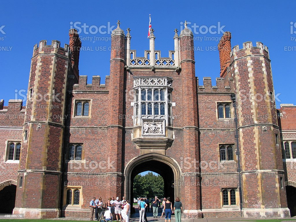 People look at Entrance to Hampton Court Palace stock photo