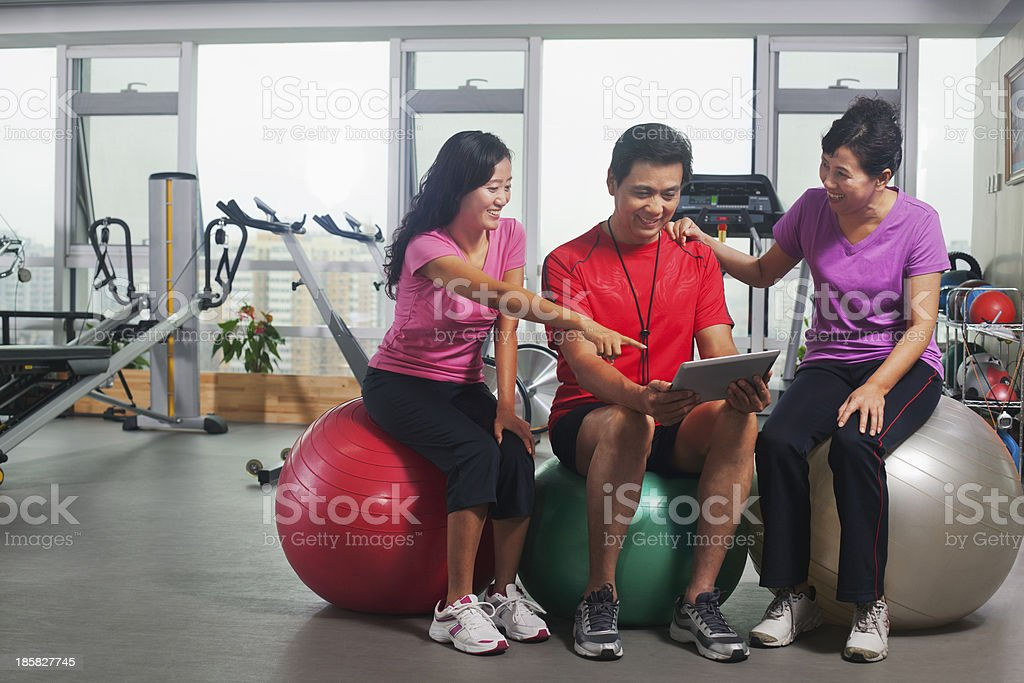 People looking at digital tablet in the gym royalty-free stock photo