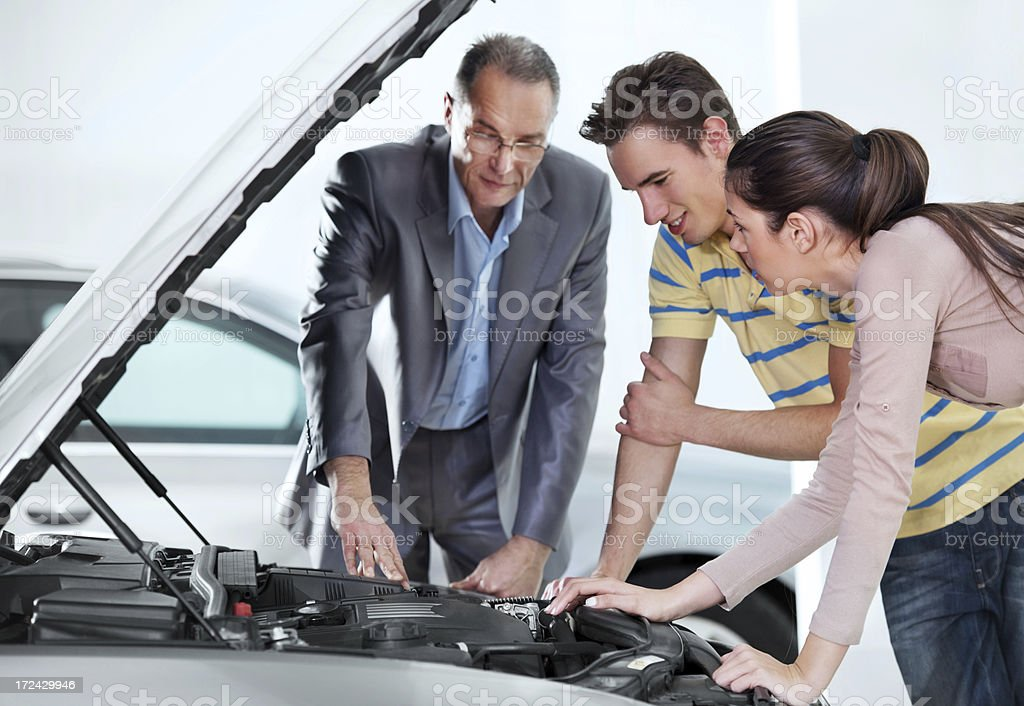 People looking at the new car engine royalty-free stock photo