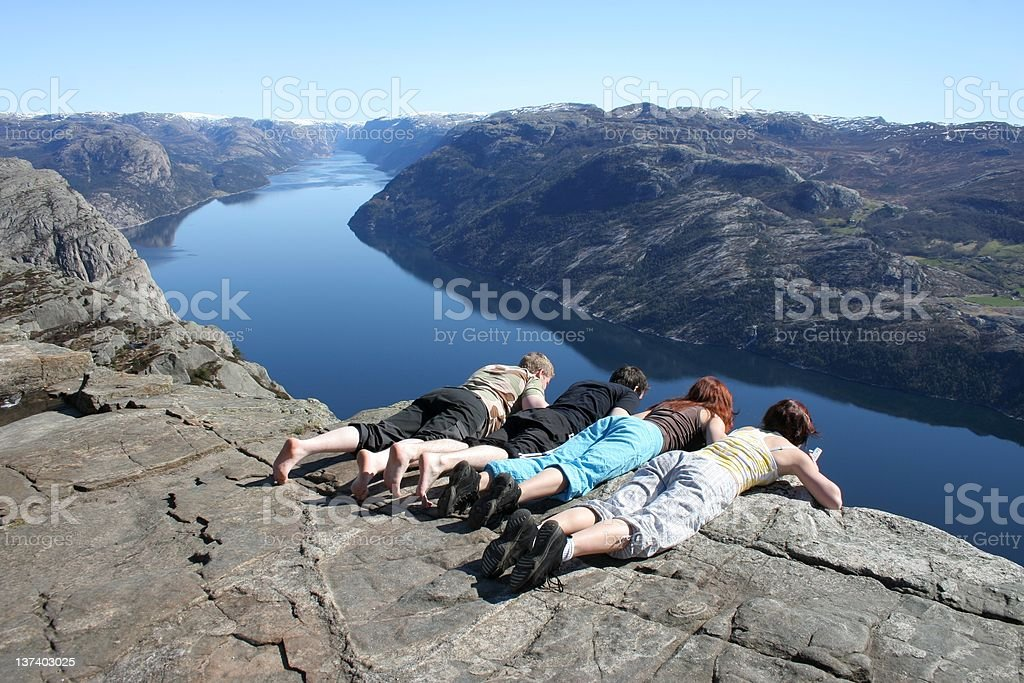 People looking down at pulpit rock stock photo
