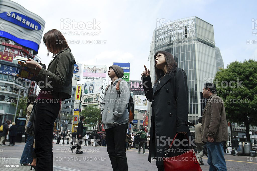 People looking for information in Shibuya royalty-free stock photo
