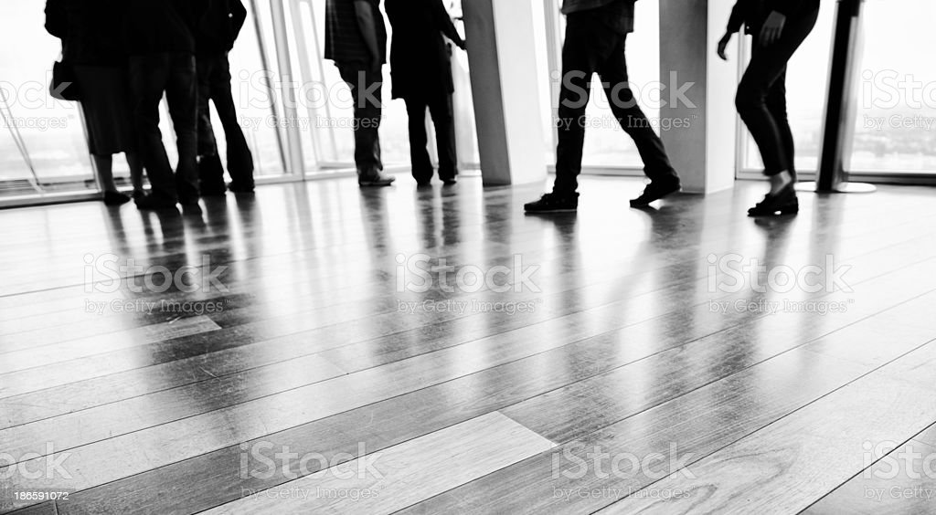 People Looking Through Window,London. Black And White stock photo