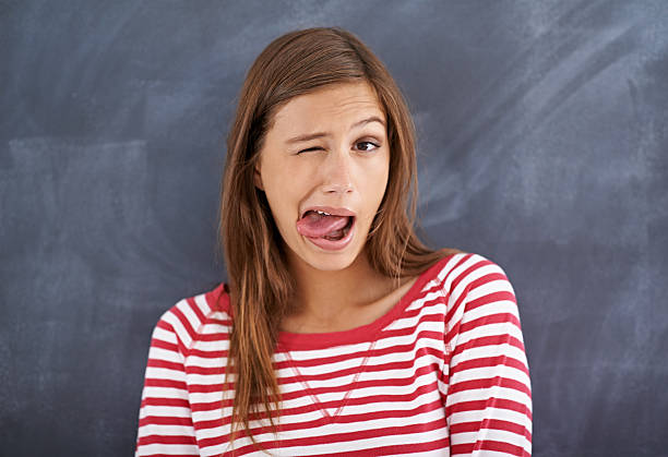 people make funny faces before they sneeze - sticking out tongue stock photos and pictures
