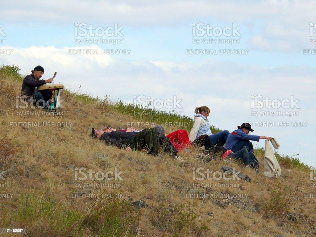 People make heathen ritual in Shamanka mountain, Arkaim, Russia stock photo