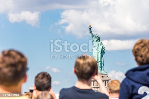 People make photo of the Statue of Liberty in New York City, NY, USA