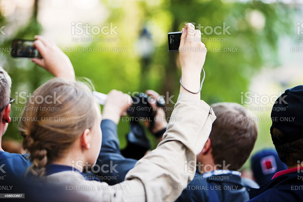 People making photos and videos in a crowd of protestors royalty-free stock photo
