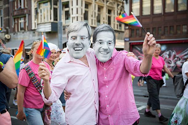 people marching at pride walk pink saturday gayeuro pride - mark rutte stockfoto's en -beelden