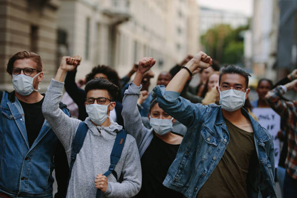 People marching together in a protest stock photo