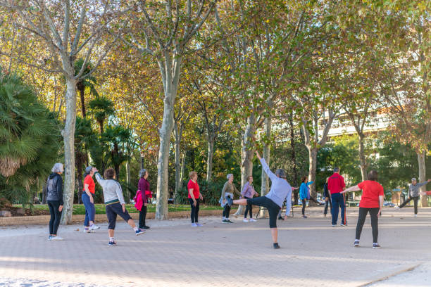 People meet to do exercises together in the park and plaza at the Templo de Debod in Madrid stock photo