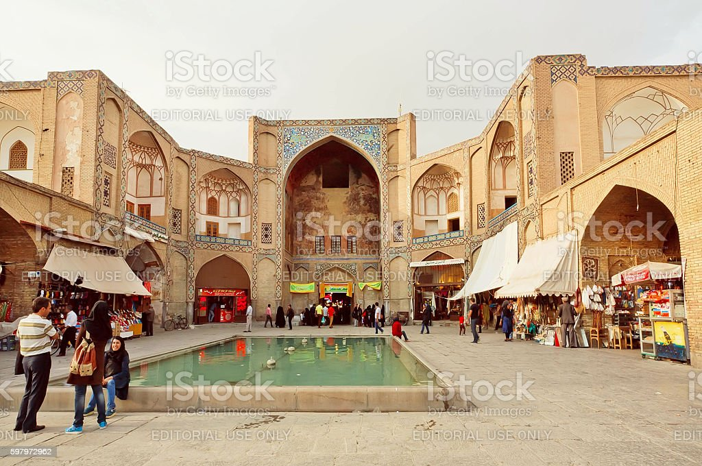 People meeting at square near 17th century bazaar stock photo