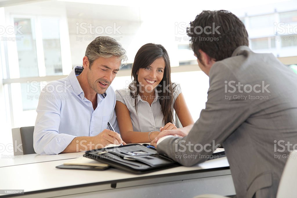People meeting in real-estate agency stock photo