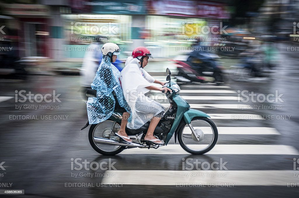 People Motorcycling Through A Storm In Vietnam stock photo