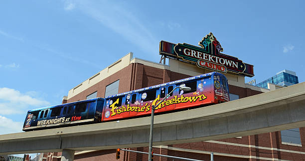 People mover past Greektown in Detroit, MI stock photo
