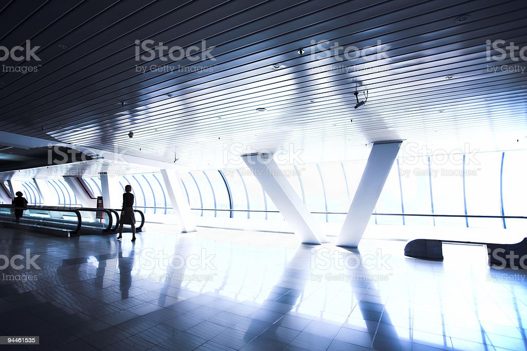 People moving in corridor royalty-free stock photo