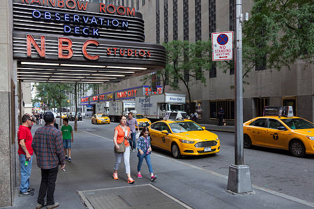 people near entrance of nbc rainbow room in new york - nbc fallon stockfoto's en -beelden