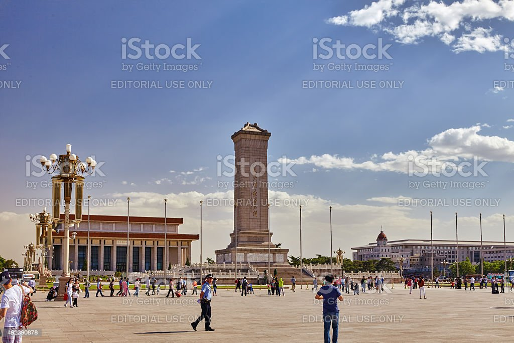 People near Monument to the People's Heroes on Tian'anmen Square stock photo