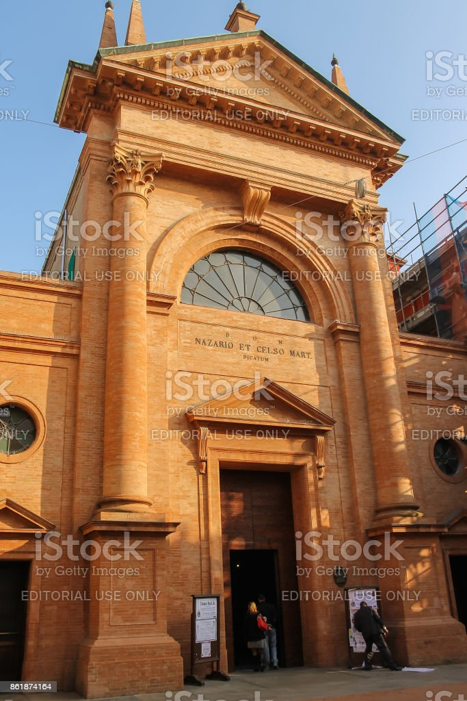 People near old church of the Saints Nazarius and Celsus in Vignola, Italy stock photo