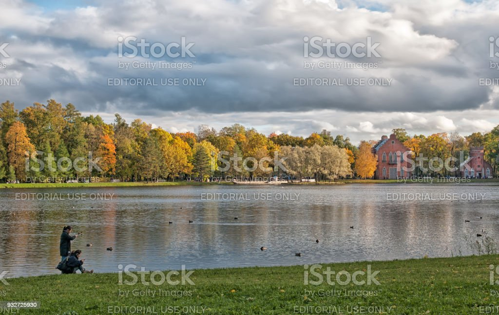 People near The Great Pond. Pushkin. Tsarskoye Selo. Russia stock photo