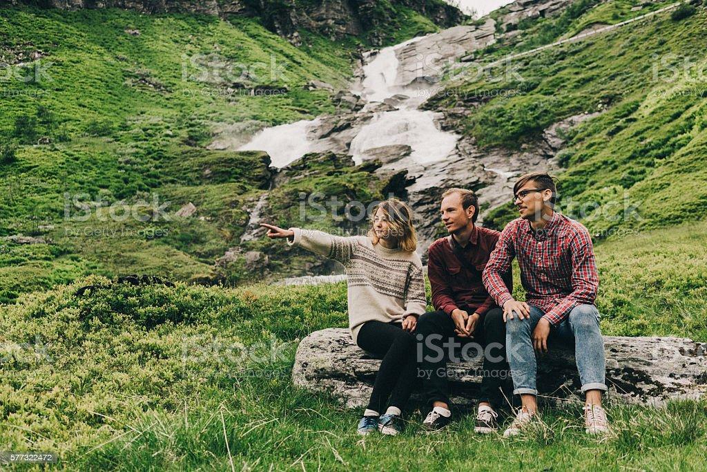 People near the waterfall stock photo