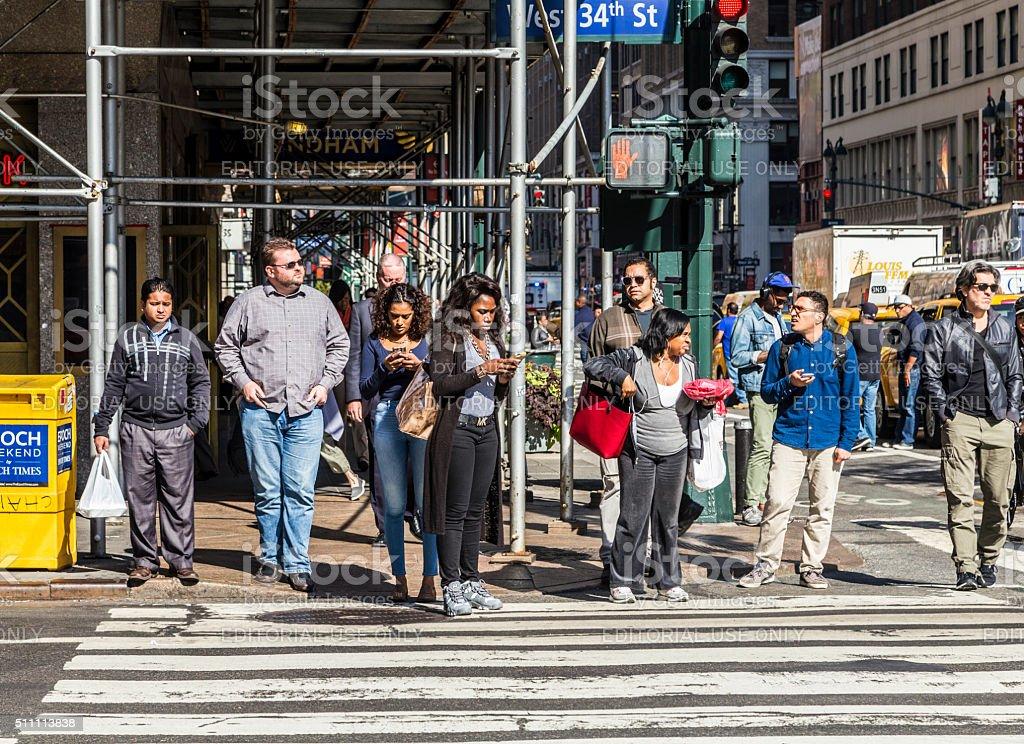 people near Wall street in Manhattan cross the street stock photo