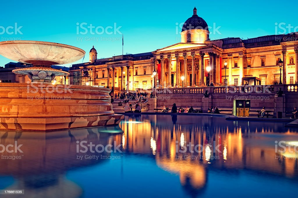 People near water in fountain in Trafalgar Square, London royalty-free stock photo