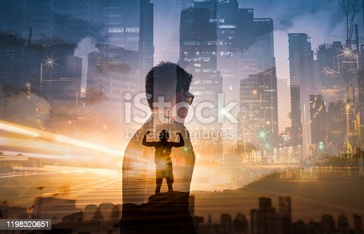 Man feeling determined standing on a  mountainside flexing.
