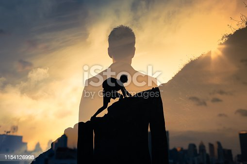 Man feeling determined climbing up a steep mountain side.