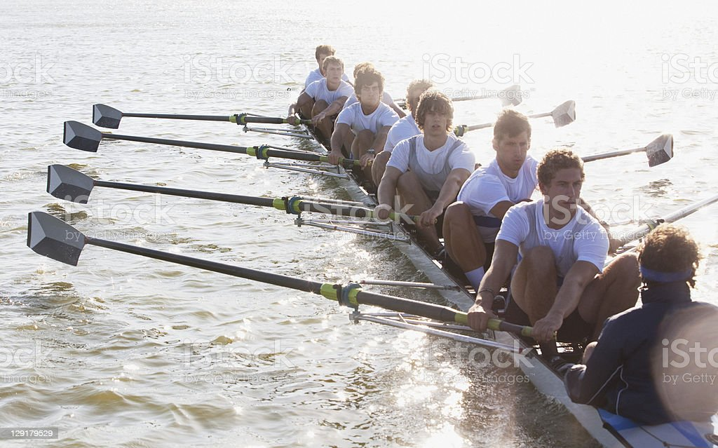 People oaring canoe stock photo